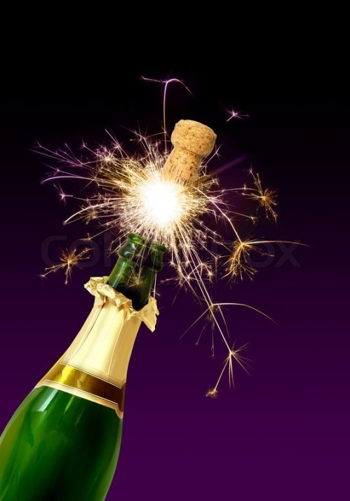 1762913-champagne-bottle-cork-popping-with-sparkling-fireworks