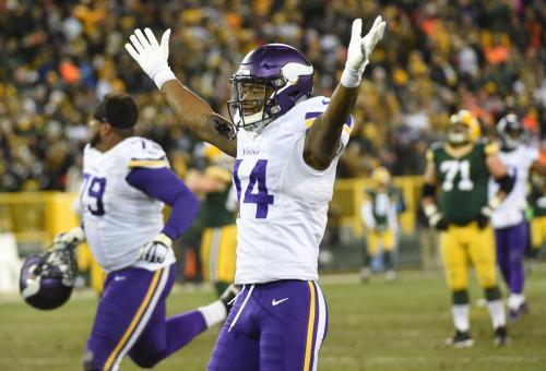 Jan 3, 2016; Green Bay, WI, USA; Minnesota Vikings wide receiver Stefon Diggs (14) celebrates after the Vikings beat the Green Bay Packers 20-13 at Lambeau Field. Mandatory Credit: Benny Sieu-USA TODAY Sports