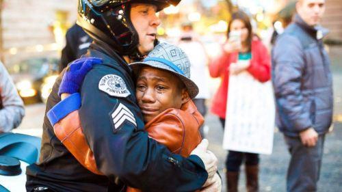 Sgt. Bret Barnum hugs Devonte Hart in Portland during Ferguson protest -